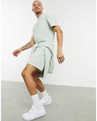 Nike Pantalones cortos en verde desgastado Just Do It