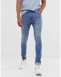 ASOS Jeans super skinny lavaggio chiaro - Blu