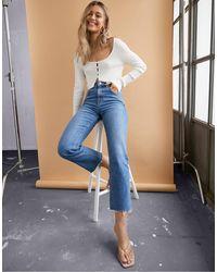ASOS Effortless - Jean court évasé stretch à taille haute - Délavage vintage moyen - Bleu