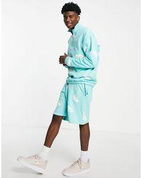 ASOS Shorts azules extragrandes con estampado integral