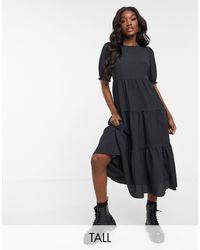 New Look Robe mi-longue texturée à volants et manches bouffantes - Noir