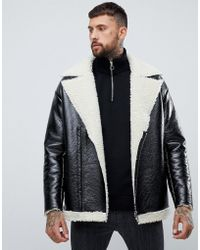ASOS Übergroße Jacke aus schwarzem Vinyl mit Innenfutter in Lammfelloptik