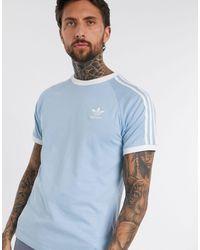 adidas Originals – T-Shirt mit den drei Streifen - Blau