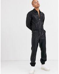 ASOS – Overall aus schwarzem Kunstleder mit Reißverschluss