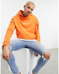 ASOS Organic Oversized Hoodie With Worldwide Embroidered Chest Print - Orange