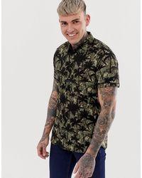 Blend Chemise manches courtes à motif camouflage et imprimé palmier - Vert