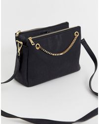 Chateau Cross Body Bag With Chain In Black