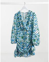 River Island Mini robe patineuse drapée à imprimé floral - Bleu