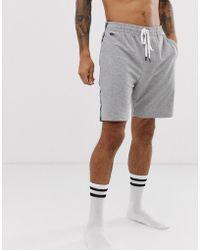 Lacoste - Pantalones cortos confort con tira en gris - Lyst