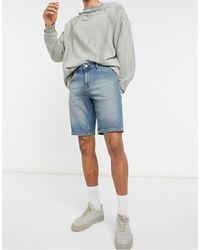 ASOS Pantaloncini di jeans slim lavaggio scuro blu