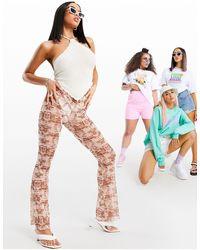 ASOS Pantalon évasé en tulle transparent imprimé abstrait - Multicolore