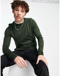 Rudie – Figurbetonter Pullover mit Rundhalsausschnitt - Grün