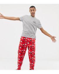 ASOS – Weihnachtlicher Pyjama mit Design aus Schweinchen und Decken - Rot