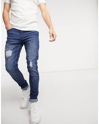 Criminal Damage – Harrow – Eng geschnittene Jeans - Blau