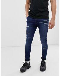 ASOS Super Spray On Jeans In Dark Wash Blue