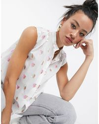 Love Moschino Blusa con maniche ad aletta bianca con cuori ricamati - Bianco