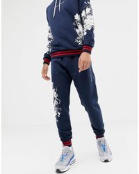 Criminal Damage - Skinny jogger In Navy With Floral Detail - Lyst