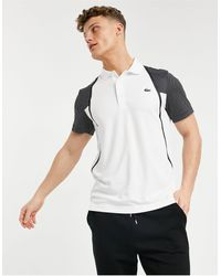 Lacoste Sport - Polo style tennis en tulle respirant à manches contrastantes - Blanc