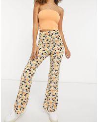Fashion Union Pantaloni comodi a fiori con fondo ampio - Multicolore