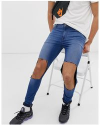 ASOS Super Spray On Jeans In Mid Blue With Open Rips
