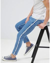 ASOS - Design Skinny Jeans In Mid Wash Blue With Frayed Side Stripe - Lyst