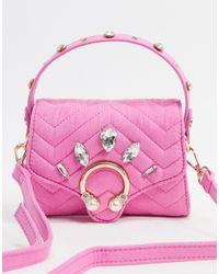 Skinnydip London – Kleine, strukturierte Tasche mit Verzierung - Pink