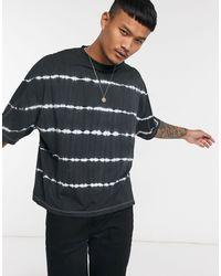 ASOS Camiseta extragrande con rayas efecto teñido anudado - Multicolor