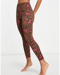 Onzie - – Yoga-7/8-Leggings mit hohem Bund und floralem Leopardenmuster - Lyst