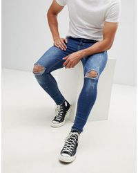 Kings Will Dream Super Skinny Jeans In Mid Wash With Paint Splatter - Blue