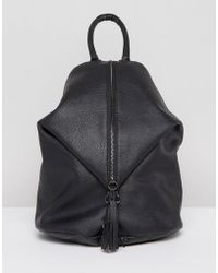 ASOS - Design Front Zip Backpack With Dog Clip And Tassel - Lyst