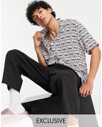 Collusion Camisa con estampado integral y solapas - Negro