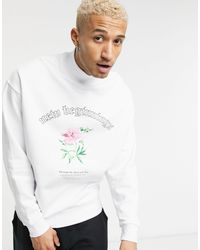 ASOS Oversized Turtle Neck Sweatshirt With Flower Chest Graphic - White