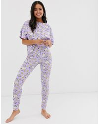 ASOS – Unicorn – Pyjamaset mit T-Shirt und Leggings mit Regenbogenstreifen - Lila