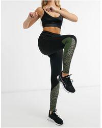 South Beach - Leggings da fitness con pannello a contrasto sul polpaccio kaki tigrato - Lyst