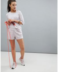 Nike Pantaloncini vita alta rosa