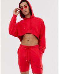 ASOS Kurzer Oversized-Trainingsanzug in Rot mit Kapuze und Shorts