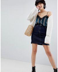 da8e08750 Minifalda vaquera sin rematar con 5 bolsillos de - Azul