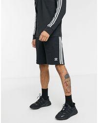 adidas Originals Shorts negros con tres rayas adicolor