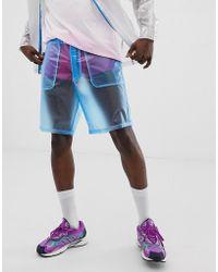 ASOS Pantalones cortos cuadrados de festival en azul transparente de (parte