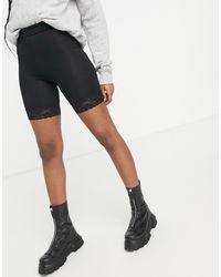 Miss Selfridge Lace Hem legging Shorts - Black