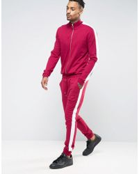 ASOS Skinny Jersey Track Jumpsuit With Side Stripe In Burgundy - Red