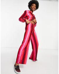 Never Fully Dressed Pantaloni a righe rosa e rosso