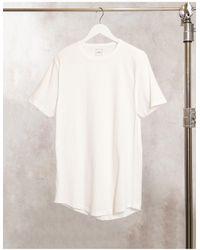 River Island – Lang geschnittenes T-Shirt mit abgerundetem Saum - Weiß