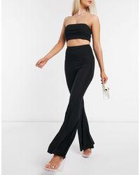 Fashionkilla Pantaloni a zampa con ruches sul retro neri - Nero
