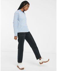 Monki Top a maniche lunghe blu e bianco a righe