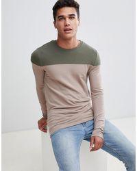 ASOS T-shirt moulant à manches longues avec encolure contrastante - Neutre
