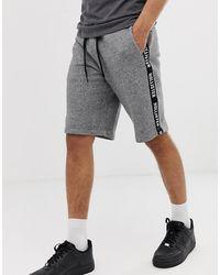 Hollister Short en molleton avec logo imprimé et bande sur le côté - chiné - Gris