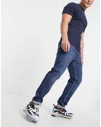 Levi's – 502 Hi-Ball – Schmal zulaufende Jeans - Blau
