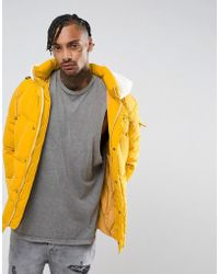 The New County Oversized Puffer Jacket In Yellow