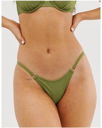 TWIIN – Purpose – Strukturierte Stringtanga-Bikinihose - Grün
